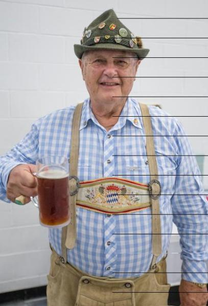 HOLLYN JOHNSON/Tribune-Herald Founder Pete Muller smiles in a German inspired outfit during the 16th Annual Oktoberfest Friday evening put on by the Rotary Club of Hilo Bay at Sangha Hall.